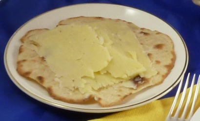 Open face cheddar cheese sandwich